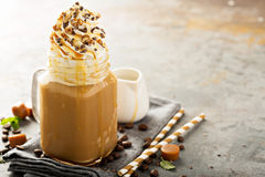Caramel iced latte with whipped cream. And syrup on light background stock images