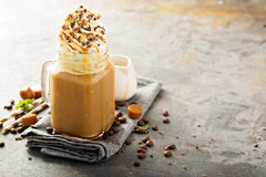 Caramel iced latte with whipped cream royalty free stock images