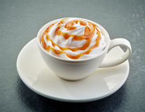 Caramel latte coffee with whipped cream royalty free stock image