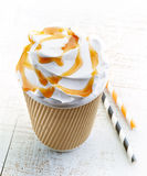 Caramel latte in paper take away coffee cup Stock Images