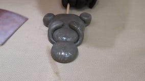 Caramel lollipop design art craft forming candy. Sugar caramel lollipop design. confectionery creative art and craft. hands forming a bear shape candy stock footage