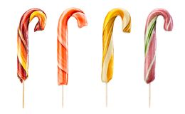 Caramel lollipops. Set of twirled caramel candies on sticks, different colors. File includes clipping path Stock Photos