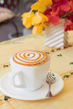 Caramel macchiato. Caramel machiato set on table with flower Royalty Free Stock Photography