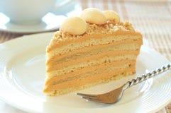 Caramel medovik cake. Made of honey and caramel cream with coffee Royalty Free Stock Photography