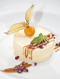 Caramel parfait. A portion of caramel parfait with a physalis and some mint on top Royalty Free Stock Photos