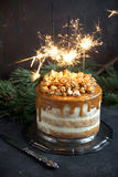 Caramel party cake with popcorn royalty free stock photos