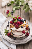 Caramel Pavlova Cake. With fresh berries Royalty Free Stock Photo