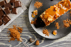 Caramel pie. Delicious caramel pie on a wooden table stock photo