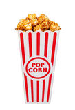Caramel pop corn in striped box bucket isolated on white Stock Photography