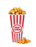 Caramel pop corn in striped box bucket isolated on white Stock Photos
