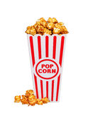 Caramel pop corn in striped box bucket isolated on white Royalty Free Stock Photos