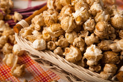 Caramel popcorn in a basket on a napkin. Close up Royalty Free Stock Photo