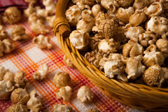 Caramel popcorn in a basket on a napkin. Close up stock photography