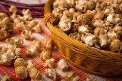 Caramel popcorn in a basket on a napkin Royalty Free Stock Photography