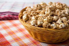 Caramel popcorn in a basket on a napkin. Close up stock images