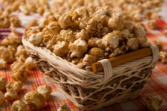 Caramel popcorn in a basket on a napkin. Close up royalty free stock images
