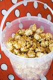 Caramel popcorn in bucket Royalty Free Stock Photos
