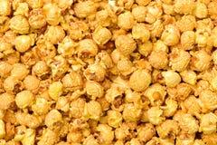 Caramel popcorn. On white background royalty free stock photography