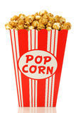 Caramel popcorn in a decorative paper popcorn cup Royalty Free Stock Photo