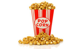 Caramel popcorn in a decorative paper popcorn cup Royalty Free Stock Image