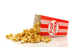 Caramel popcorn in a decorative paper popcorn cup Stock Photo