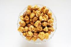Caramel popcorn on glass bowl Royalty Free Stock Photos