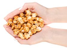 Caramel popcorn in hand. On a white background, top view royalty free stock image