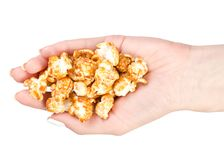 Caramel popcorn in hand. On a white background, top view royalty free stock photo