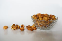 Caramel popcorn. A photo of caramel popcorn on glass blow  on white background, close up Royalty Free Stock Photography