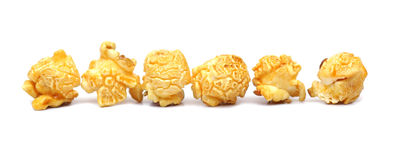 Caramel popcorn. Row of caramel popcorn isolated Royalty Free Stock Photos