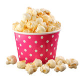 Caramel popcorn in small paper cup. Isolated on white background Stock Photography