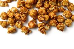 Caramel popcorn. On white background stock images