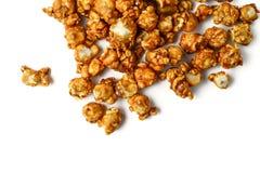 Caramel popcorn. On white background royalty free stock image