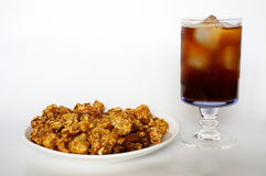 Caramel popcorn on white plate and cola Royalty Free Stock Photo