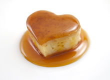 Caramel. Pudding isolated on white. Romantic heart shape sweet stock photos