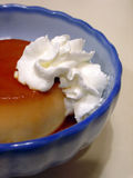 Caramel pudding with whipped cream Stock Photo