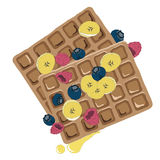 Caramel sauce flowing over a waffle with berries Royalty Free Stock Image