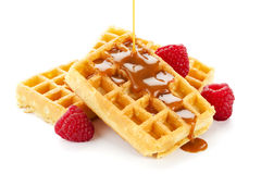 Caramel sauce flowing over waffles Royalty Free Stock Images