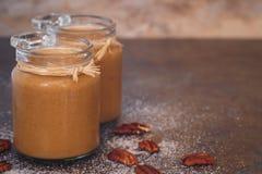 Caramel sauces in a preserving jar Stock Image