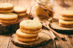 Caramel shortbread cookies on wooden background. royalty free stock photos