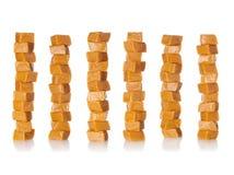 Caramel stacks. Caramel candy square shape stacks image isolated on a white background Royalty Free Stock Photos