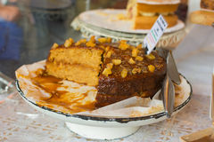 Caramel and sticky toffee cake on sale with slices cut out at on Stock Image