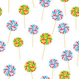Caramel Striped Candies on Sticks Seamless Pattern. Caramel striped candy on sticks seamless pattern. Funny sweet cartoon lollies endless texture of Stock Photos