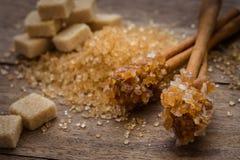 Caramel sugar on cinnamon sticks and brown sugar Royalty Free Stock Photo