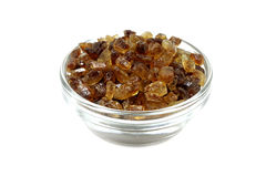 Caramel sugar crystals in a glass dish Royalty Free Stock Image