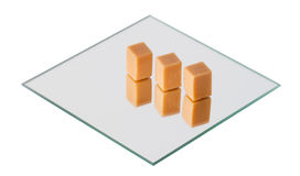 Caramel sweets on a mirror, isolated Stock Photo