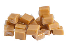 Caramel sweets in plastic wrap, isolated Royalty Free Stock Photo