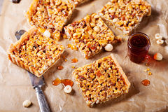 Caramel tart with nuts, maple syrup and honey. Caramel tart with nuts, maple syrup and honey on a wooden background. Top view stock images