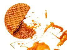 Caramel thin round waffle with Caramel sauce isolated on white background. Dutch stroopwafel with Golden Butterscotch toffee syrup. Top view stock photography