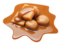 Caramel toffee and sauce isolated Royalty Free Stock Photography